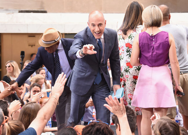 "Al Roker and Matt Lauer of NBC's ""Today"" greet fans at Rockefeller Plaza on June 23, 2016 in New York City. (Photo by Larry Busacca/Getty Images)"