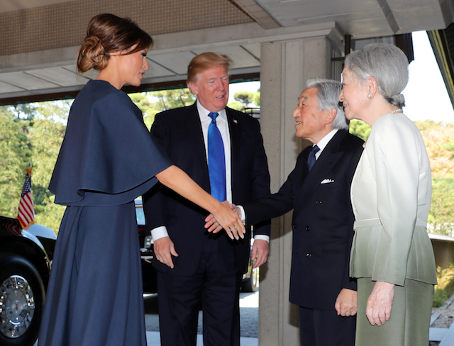 U.S. President Donald Trump, second left, and First Lady Melania Trump, left, are welcomed by Emperor Akihito, second right, and Empress Michiko, right, upon their arrival at the Imperial Palace Monday, Nov. 6, 2017 in Tokyo.REUTERS/Eugene Hoshiko/Pool - RC120F93FC20