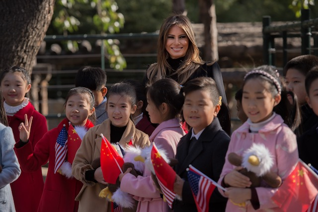 US First Lady Melania Trump poses for a photograph after she presented stuffed toy eagles, from the US, to children at the Beijing Zoo in Beijing on November 10, 2017. / AFP PHOTO / NICOLAS ASFOURI (Photo credit should read NICOLAS ASFOURI/AFP/Getty Images)