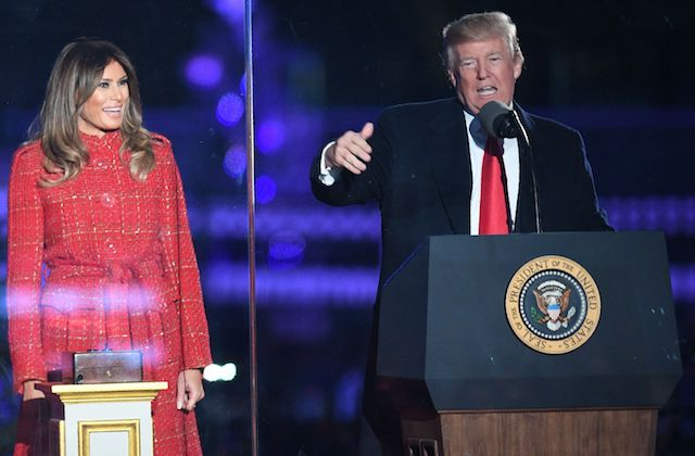 US President Donald Trump (R) speaks as First lady Melania Trump smiles during the 95th annual National Christmas Tree Lighting ceremony at the Ellipse in President's Park near the White House in Washington, DC on November 30, 2017. / AFP PHOTO / JIM WATSON (Photo credit should read JIM WATSON/AFP/Getty Images)