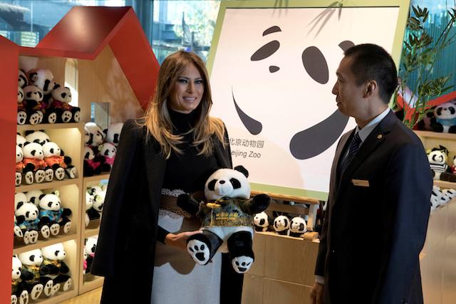 U.S. first lady Melania Trump poses with a panda plushie after visiting the panda enclosure at the zoo in Beijing, China, November 10, 2017. REUTERS/Ng Han Guan/Pool - RC1C238E1A10