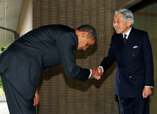 U.S. President Barack Obama is greeted by Emperor Akihito upon arriving at the Imperial Palace in Tokyo November 14, 2009. REUTERS/Jim Young/File photo