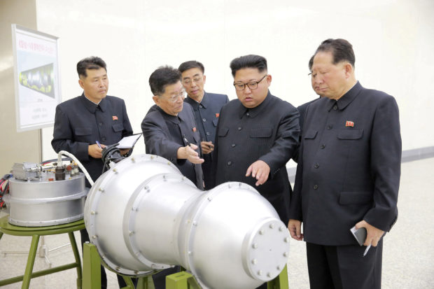 North Korean leader Kim Jong Un provides guidance with Ri Hong Sop (2nd L) and Hong Sung Mu (R) on a nuclear weapons program in this undated photo released by North Korea's Korean Central News Agency (KCNA) in Pyongyang September 3, 2017. To Match Special Report USA-NUCLEAR/ICBM KCNA via REUTERS
