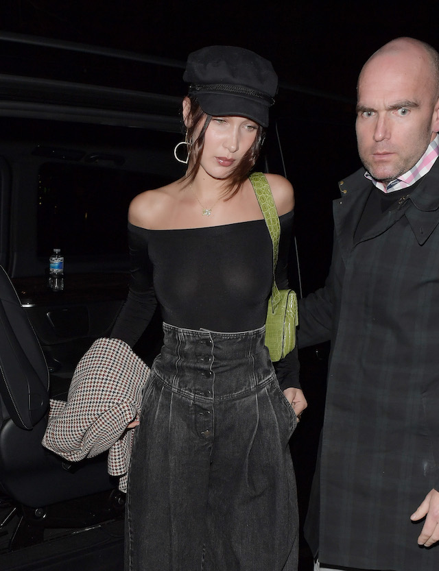 Bella Hadid seen braless as she steps out in London for dinner with friends at ChinaTang Restaurant at The Dorchester Hotel. Bella was seen looking up beat and happy as she left the restaurant as she smiled for photographers. (Photo: Craig/Splash News)