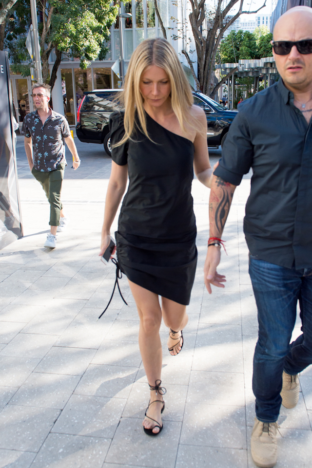 Gwyneth Paltrow arrives at her Goop popup store in Miami desgin district to sign books. On her way in she tried to hide her face while wearing a black dress. <P> Pictured: Gwyneth Paltrow <B>Ref: SPL1636404 151217 </B><BR /> Picture by: AM/Splash News