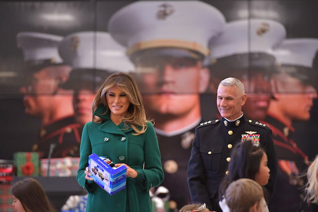 US First Lady Melania Trump helps with the Marine Corps Reserve Toys for Tots Campaign at Joint Base Anacostia-Bolling in Washington, DC on December 13, 2017 / AFP PHOTO / MANDEL NGAN (Photo credit should read MANDEL NGAN/AFP/Getty Images)