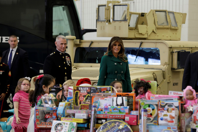 U.S. first lady Melania Trump arrives to help sort and box toys for the Marine Corps Reserve Toys for Tots campaign at Joint Base Anacostia-Bolling in Washington, U.S., December 13, 2017. REUTERS/Yuri Gripas - RC1490EC8250