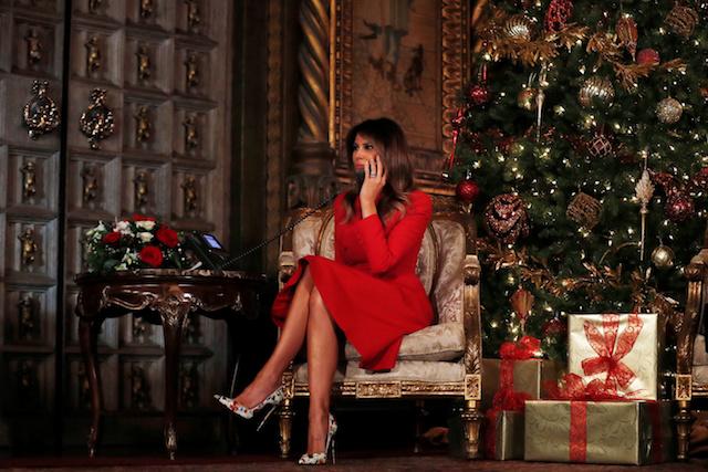 First Lady Melania Trump participates in NORAD (North American Aerospace Defense Command) Santa Tracker phone calls with children at Mar-a-Lago estate in Palm Beach, Florida, U.S., December 24, 2017. REUTERS/Carlos Barria - RC1DE2017FB0