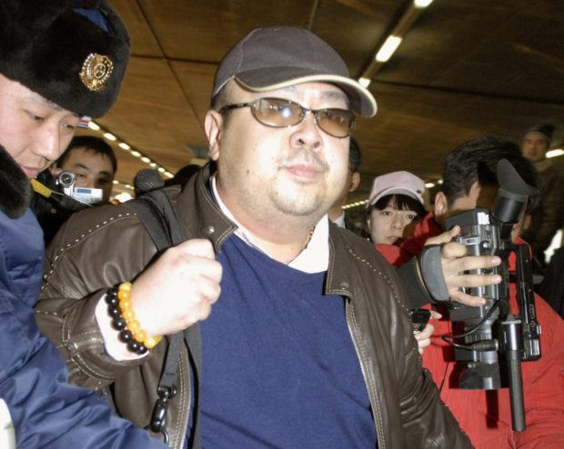 Kim Jong Nam arrives at Beijing airport in Beijing, China, in this photo taken by Kyodo February 11, 2007. Picture taken February 11, 2007. Mandatory credit Kyodo/via REUTERS