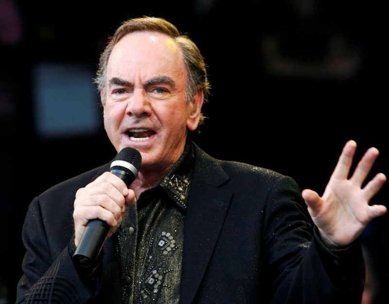 FILE PHOTO: U.S. singer Neil Diamond performs at the Glastonbury Festival 2008 in Somerset in south west England June 29, 2008. REUTERS/Luke MacGregor/File Photo