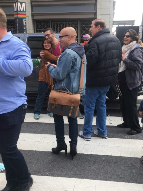 A bald man wears heels during a Washington, D.C. protest Jan 27, 2018 (The Daily Caller/Julia Nista)