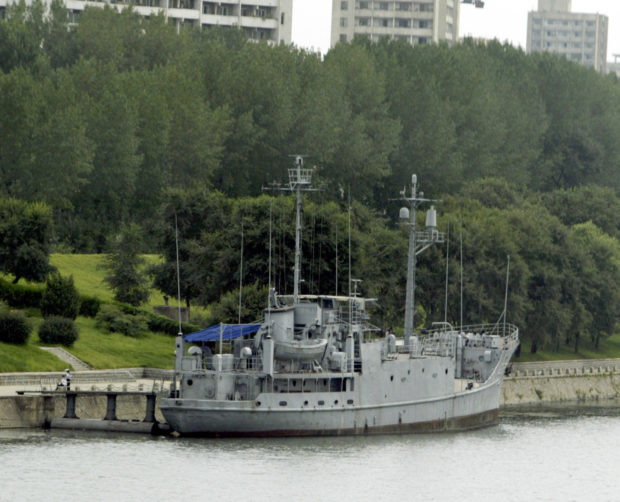 The United States' navy spy ship USS Pueblo sits on Daedong river in Pyongyang August 16, 2003. The spy ship was seized by the North Korean navy with 83 crew in international waters in 1968. The 82 survivors were freed after nearly a year of tense negotiations Civic representatives of North and South Korea held a four-day joint festival in Pyongyang to celebrate the 58th anniversary of the National Liberation Day from Japan's colonial rule (1919-1945) as the Korean Peninsula's security has been an international concern since North Korea disclosed its nuclear weapons program. REUTERS/Lee Jae-Won