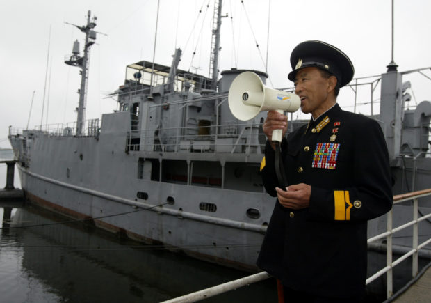 North Korean four-star general Park In-ho (64), who participated in a battle to seize the United States' navy spy ship USS Pueblo in 1968, briefs visitors in front of the spy ship on a river in Pyongyang May 3, 2004. The spy ship was seized by the North Korean navy with 83 crew in 1968. The 82 survivors were freed after nearly a year of tense negotiations. About 300 South Korean workers completed on Monday a four-day trip to Pyongyang for an inter-Korean May Day celebration. REUTERS/Lee Jae-Won