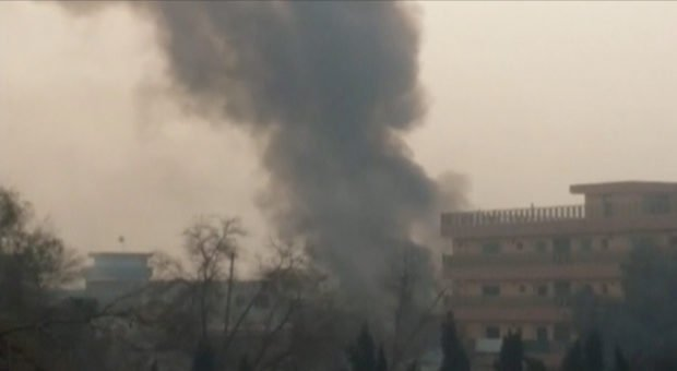 Smoke rises at the site of a blast near the office of the Save the Children aid agency in Jalalabad, Afghanistan, in this still image taken from Reuters TV footage, January 24, 2018. REUTERS/ReutersTV