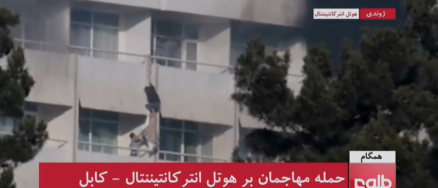 A man is seen using sheets to climb out of a balcony railing at Kabul's Intercontinental Hotel, after gunmen attacked the hotel, in Kabul, Afghanistan, in this still image taken from a video supplied by TOLOnews January 21, 2018. TOLOnews/Reuters TV/via REUTERS