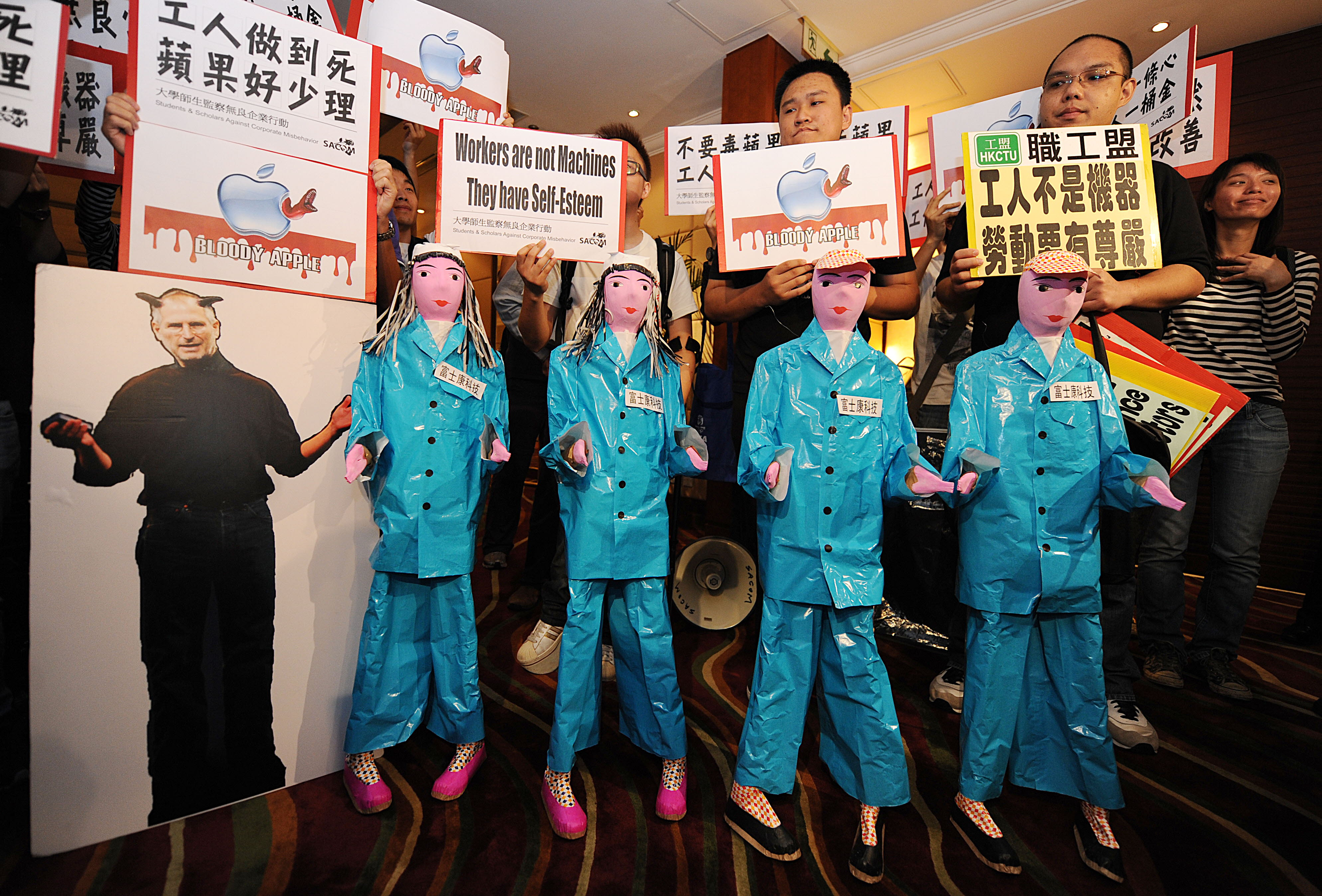 Students protest with model effigies of workers who have committed suicide at Foxconn in China during the companies' AGM in Hong Kong on June 8, 2010. (Photo: CLARKE/AFP/Getty Images)