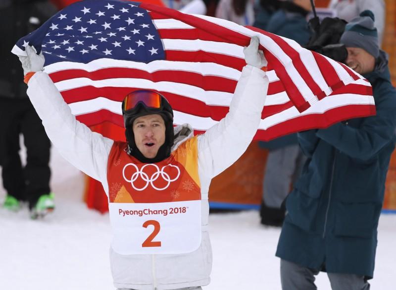 Snowboarding - Pyeongchang 2018 Winter Olympics - Men's Halfpipe Finals - Phoenix Snow Park – Pyeongchang, South Korea - February 14, 2018 - Shaun White of the U.S. celebrates with the U.S. flag. REUTERS/Jorge Silva