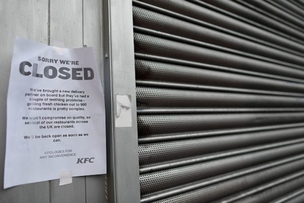 A sign outside a closed KFC fast food store in south London is closed on February 19, 2018 explains the closure is due to a shortage of fresh chicken. US fast food chain KFC said on February 19 it had been forced to close many restaurants in Britain because of a new supplier failing to deliver chicken in time, generating some tongue-in-cheek outrage on Twitter. / AFP PHOTO / BEN STANSALL (Photo credit should read BEN STANSALL/AFP/Getty Images)