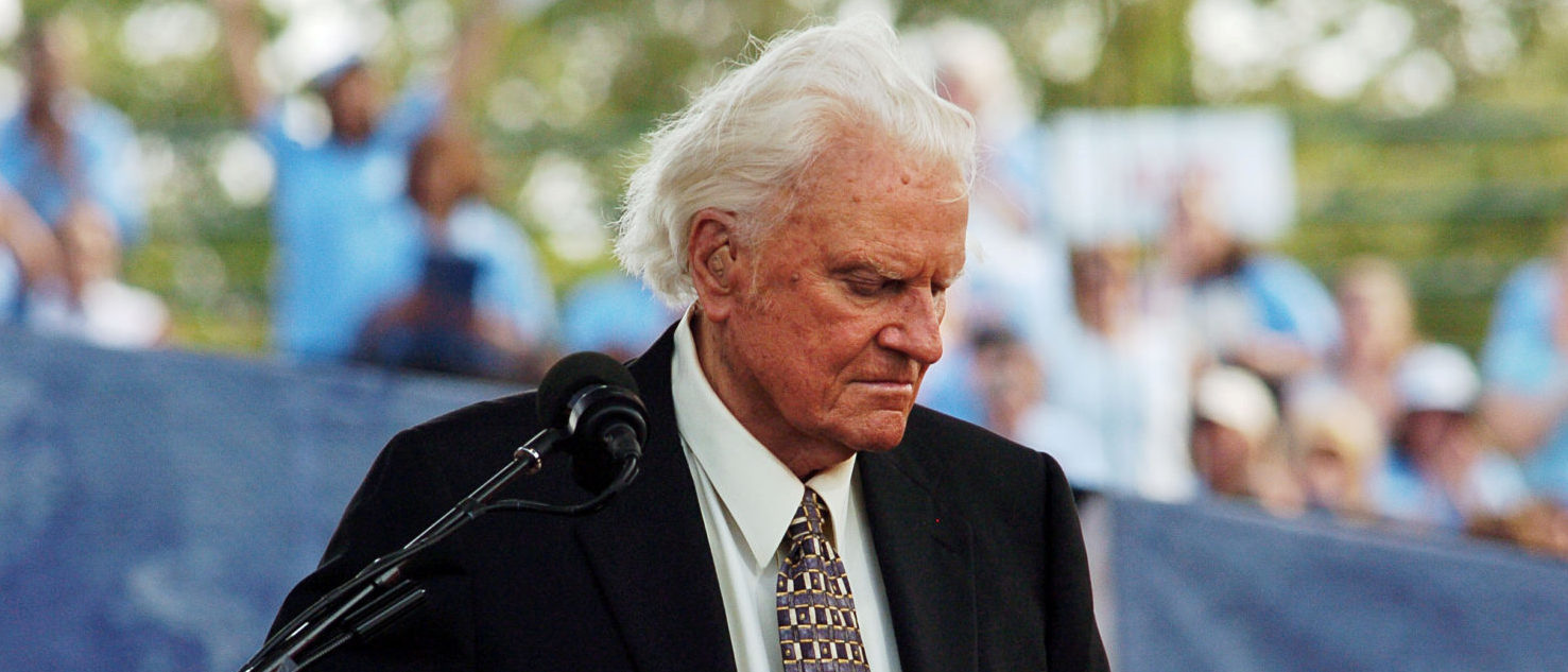 FILE PHOTO: Evangelist Billy Graham speaks during the final day of his Crusade at Flushing Meadows Park in New York June 26, 2005. REUTERS/Keith Bedford /File Photo