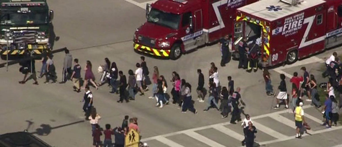 Students are evacuated from Marjory Stoneman Douglas High School during a shooting incident in Parkland, Florida, U.S. February 14, 2018 in a still image from video. WSVN.com via REUTERS.