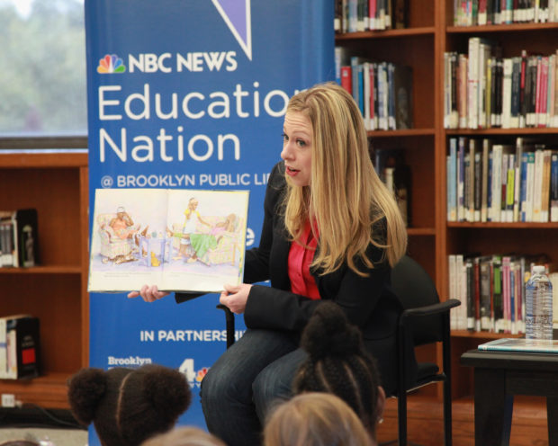 """NEW YORK, NY - SEPTEMBER 27: TV personality Chelsea Clinton reads to children during Chelsea Clinton Story Time Reading at Brooklyn Public Library on September 27, 2012 in New York City. Clinton read """"Amazing Grace"""" and """"The Gingerbread Boy"""" to students from Brooklyn public schools PS 9 and PS 399. (Photo by Taylor Hill/Getty Images)"""