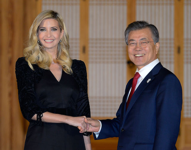 SEOUL, SOUTH KOREA - FEBRUARY 23: South Korean President Moon Jae-In (R) shakes hands with Ivanka Trump (L) during their dinner at the Presidential Blue House on February 23, 2018 in Seoul, South Korea. Ivanka Trump is on a four-day visit to South Korea to attend the closing ceremony of the Pyeongchang Winter Olympics and to meet South Korean President Moon. (Photo by Kim Min-Hee-Pool/Getty Images)