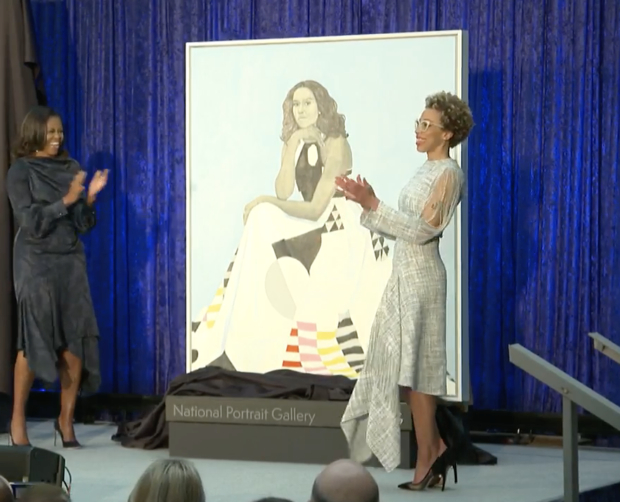 Michelle Obama claps at portrait unveiling. (Photo: Screenshot/MSNBC)