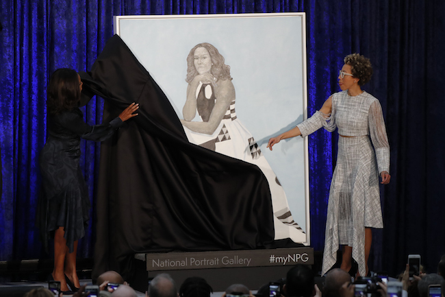 Artist Amy Sherald and former first lady Michelle Obama participate in the unveiling of Mrs. Obama's portrait at the Smithsonian's National Portrait Gallery in Washington, February 12, 2018. REUTERS/Jim Bourg
