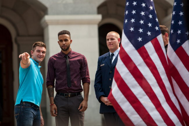 Alek Skarlatos (L-R), Anthony Sadler, and Spencer Stone, who helped thwart an attack on a French train last August, wait to be introduced during a celebration honoring them in Sacramento, California September 11, 2015. REUTERS/Max Whittaker