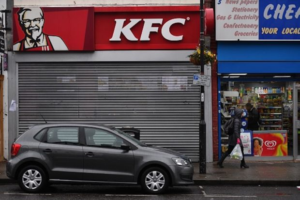 Pedestrians pass outside a closed KFC fast food store in south London on February 19, 2018. US fast food chain KFC said on February 19 it had been forced to close many restaurants in Britain because of a new supplier failing to deliver chicken in time, generating some tongue-in-cheek outrage on Twitter. / AFP PHOTO / BEN STANSALL (Photo credit should read BEN STANSALL/AFP/Getty Images)
