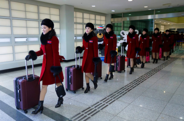 North Korean cheering squads arrive at the Korean-transit office near the Demilitarized Zone in Paju, South Korea, February 7, 2018. REUTERS/Ahn Young-joon/Pool