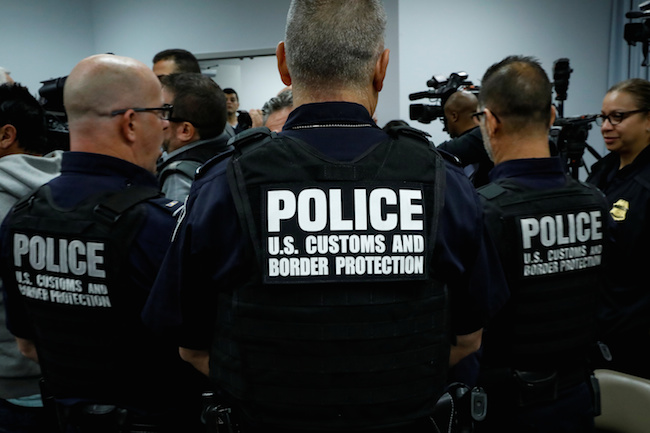U.S. Customs and Border Protection officers attend a speech by U.S. Attorney General Jeff Sessions about the Trump Administration efforts to combat the opioid crisis at John F. Kennedy International Airport in New York City, October 27, 2017. REUTERS/Brendan McDermid