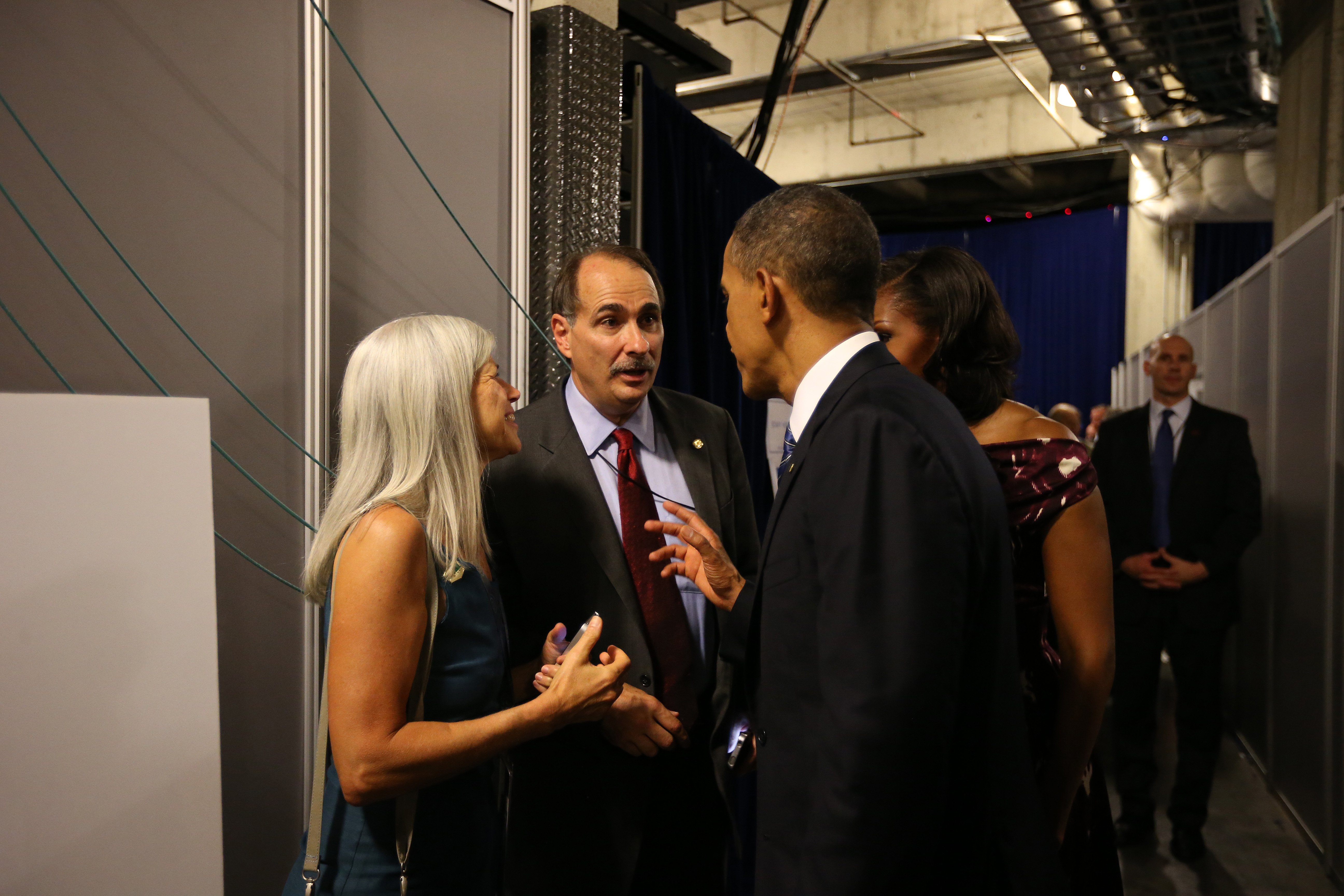 CHARLOTTE, NC - SEPTEMBER 06: (AFP OUT) U.S. President Barack Obama and First Lady Michelle Obama talk with senior campaign advisor David Axelrod following Obama's speech at the Democratic National Convention at Time Warner Cable Arena on September 6, 2012 in Charlotte, North Carolina. The DNC nominated U.S. President Barack Obama as the Democratic presidential candidate. (Photo by Doug Mills-Pool/Getty Images)