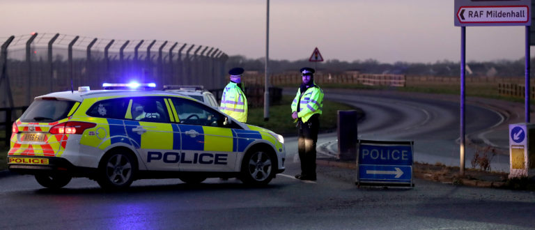 British police stand guard at the entrance to the US Air Force base at RAF Mildenhall, Suffolk, Britain December 18, 2017. REUTERS/Chris Radburn - RC129AFFCFF0