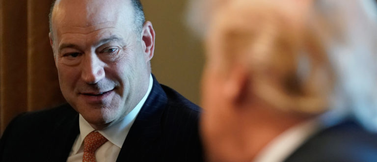President Donald Trump looks back at his outgoing economic adviser Gary Cohn during a cabinet meeting at the White House in Washington, March 8, 2018. REUTERS/Kevin Lamarque