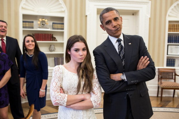 """WASHINGTON, DC - NOVEMBER 15: In this handout image provided by The White House, U.S. President Barack Obama jokingly mimics U.S. Olympic gymnast McKayla Maroney's """"not impressed"""" expression while greeting members of the 2012 U.S. Olympic gymnastics teams in the Oval Office November 15, 2012 at the White House in Washington, DC. Maroney's expression became an internet sensation when during the ceremony for her 2012 Olympic vault silver medal she was photographed giving a brief look of disappointment with her lips pursed to the side. Steve Penny, USA Gymnastics President, and Savannah Vinsant laugh at left. (Photo by Pete Souza/The White House via Getty Images)"""