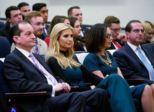 (L-R) Labor Secretary Alex Acosta, Ivanka Trump, Department of Justice Public Affairs Director Sarah Flores, and Health and Human Services Secretary Alex Azar watch as US President Donald Trump speaks during a discussion at the Generation Next Summit, a White House Forum featuring millennial voters and administration officials, in the South Court Auditorium of the Eisenhower Executive Office Building, next to the White House, on March 22, 2018 in Washington, DC. / AFP PHOTO / MANDEL NGAN (Photo credit should read MANDEL NGAN/AFP/Getty Images)