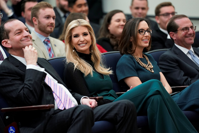U.S. Secretary of Labor Alex Acosta, White House senior advisor Ivanka Trump, Justice Department Public Affairs Director Sarah Flores and Secretary of Health and Human Services (HHS) Alex Azar, look on as U.S. President Donald Trump participates in a youth forum titled Generation Next, at the White House in Washington, U.S. March 22, 2018. REUTERS/Jonathan Ernst