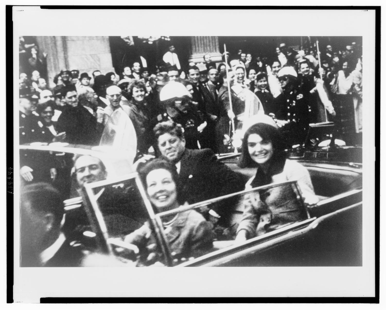 Former U.S. President John F. Kennedy (C), first lady Jacqueline Kennedy (R) and Texas Governor John Connally (L) and his wife are pictured riding in the presidential motorcade moments before Kennedy was shot in Dallas,Texas, in this handout image taken on November 22, 1963. REUTERS/Victor Hugo King/Library of Congress/Handout