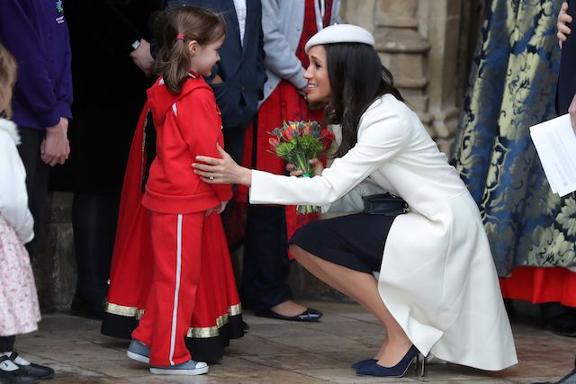 US actress Meghan Markle (R), fiancee of Britain's Prince Harry receives a posy of flowers from a young girl after attending a Commonwealth Day Service at Westminster Abbey in central London, on March 12, 2018. Britain's Queen Elizabeth II has been the Head of the Commonwealth throughout her reign. Organised by the Royal Commonwealth Society, the Service is the largest annual inter-faith gathering in the United Kingdom. / AFP PHOTO / Daniel LEAL-OLIVAS (Photo credit should read DANIEL LEAL-OLIVAS/AFP/Getty Images)