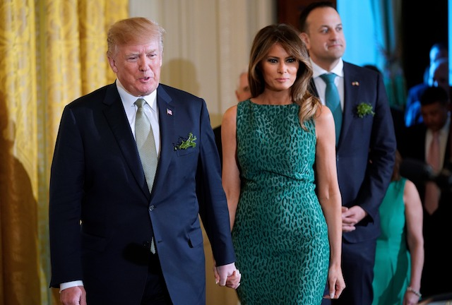 US President Donald Trump, and First Lady Melania Trump arrive on stage with Ireland's Prime Minister Leo Varadkar for a Shamrock presentation ceremony in the East Room of the White House on March 15, 2018 in Washington, DC. / AFP PHOTO / MANDEL NGAN (Photo credit should read MANDEL NGAN/AFP/Getty Images)