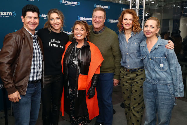 NEW YORK, NY - MARCH 27: (L-R) Actors Michael Fishman, Sarah Chalke, Roseanne Barr, John Goodman, SiriusXM host Sandra Bernhard and Lecy Goranson pose for photos during SiriusXM's Town Hall with the cast of Roseanne on March 27, 2018 in New York City. (Photo by Astrid Stawiarz/Getty Images for SiriusXM)
