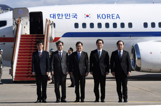 Chung Eui-yong, head of the presidential National Security Office, Suh Hoon, chief of the South's National Intelligence Service, and other members of South Korean delegation pose before boarding an aircraft as they leave for Pyongyang at a military airport in Seongnam, south of Seoul, South Korea March 5, 2018. REUTERS/Jung Yeon-je/Pool