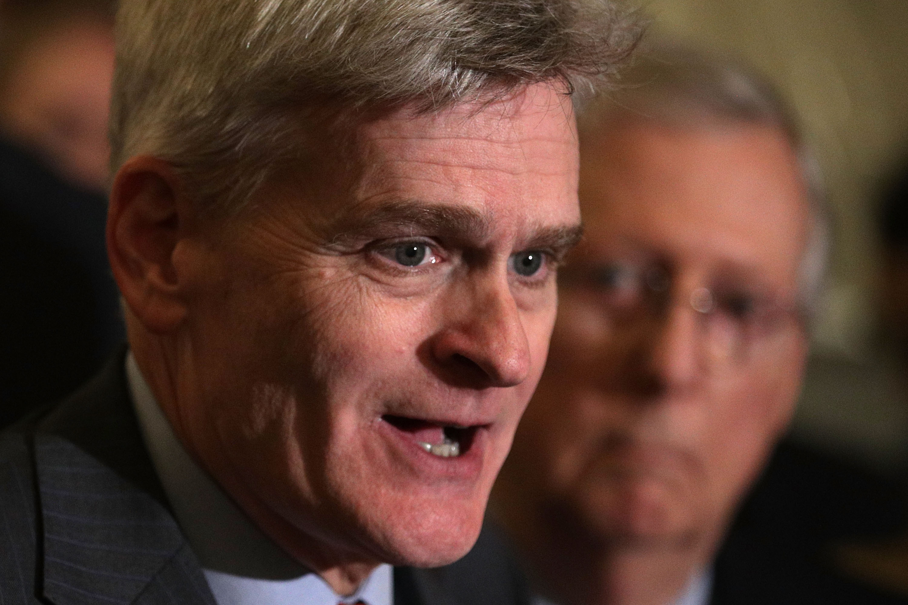 WASHINGTON, DC - SEPTEMBER 19: U.S. Sen. Bill Cassidy (R-LA) (L) speaks as Senate Majority Leader Sen. Mitch McConnell (R-KY) (R) listens during a news briefing after the weekly Senate Republican policy luncheon at the Capitol September 19, 2017 in Washington, DC. Senate Republican held a weekly policy luncheon to discuss GOP agenda. (Photo by Alex Wong/Getty Images)