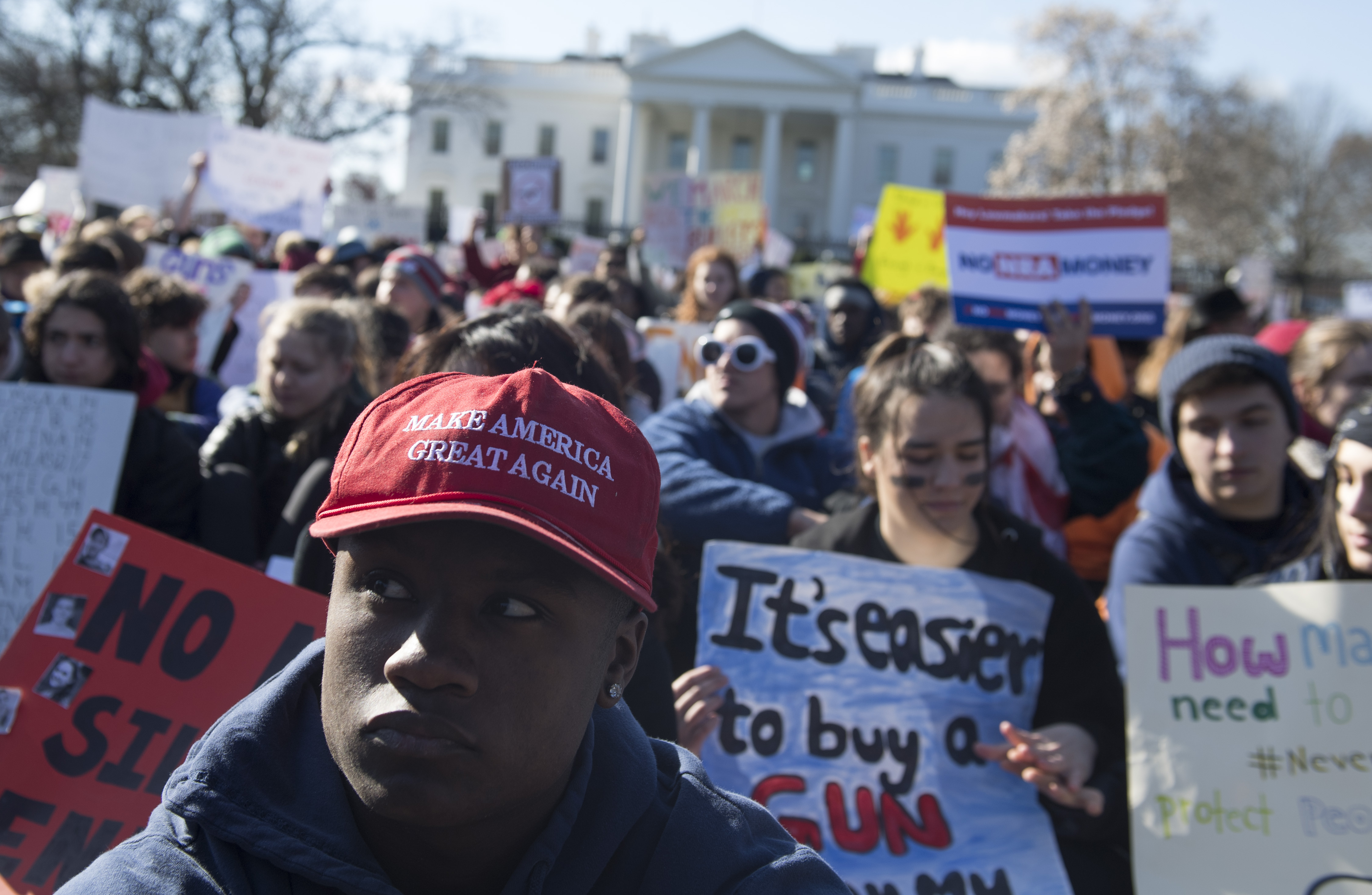Thousands of local students sit for 17 minutes in honor of the 17 students killed last month in a high school shooting in Florida, during a nationwide student walkout for gun control in front the White House in Washington, DC, March 14, 2018. Students across the US walked out of classes on March 14, in a nationwide call for action against gun violence following the shooting deaths last month at a Florida high school. The nationwide protest is being held one month to the day after Nikolas Cruz, a troubled 19-year-old former student at Stoneman Douglas, unleashed a hail of gunfire on his former classmates. (SAUL LOEB/AFP/Getty Images)