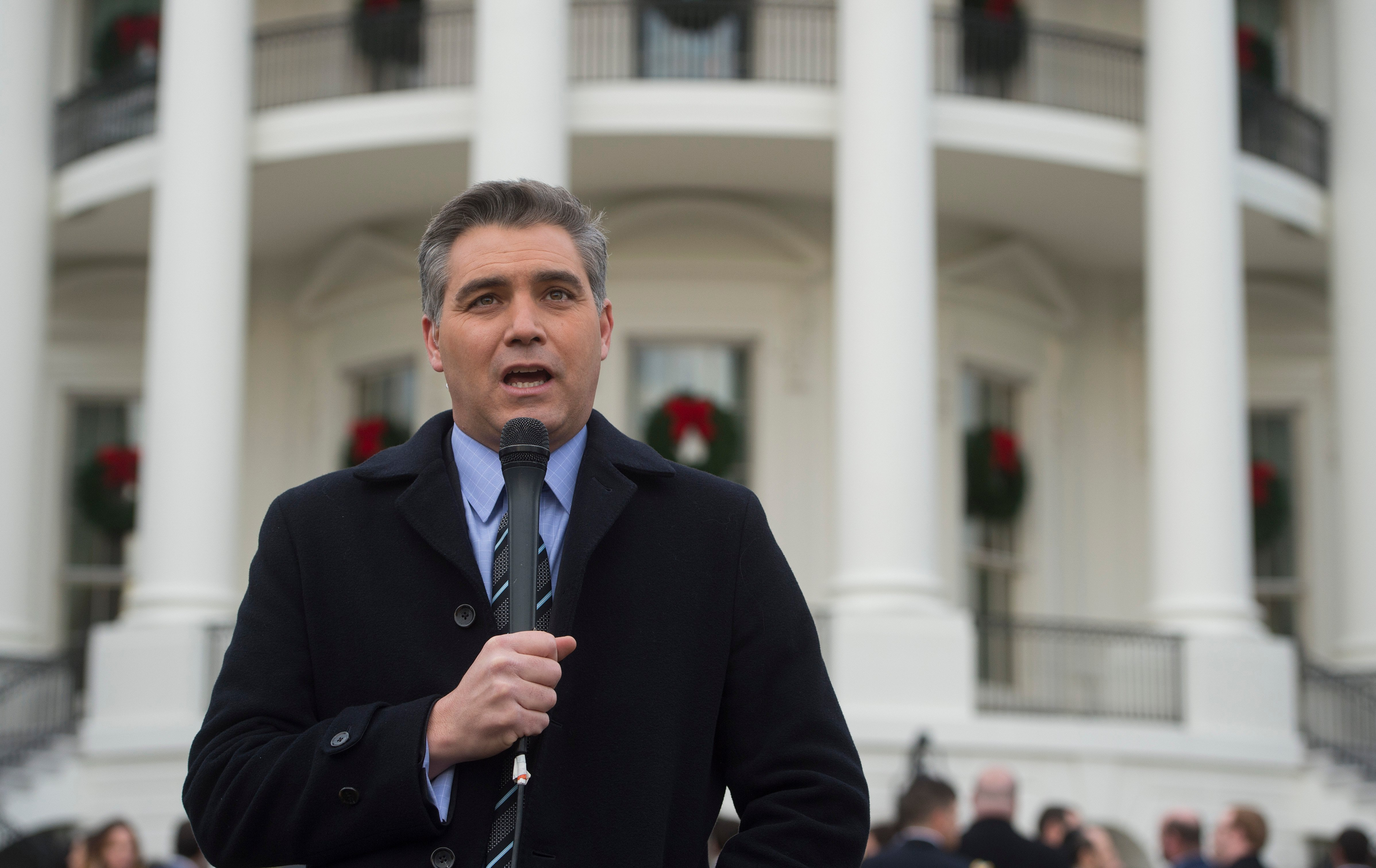 """Jim Acosta, Senior White House Correspondent for CNN, speaks on camera after US President Donald Trump held an event about the passage of tax reform legislation on the South Lawn of the White House in Washington, DC, December 20, 2017. Trump hailed a """"historic"""" victory Wednesday as the US Congress passed a massive Republican tax cut plan, handing the president his first major legislative achievement since taking office nearly a year ago. (SAUL LOEB/AFP/Getty Images)"""
