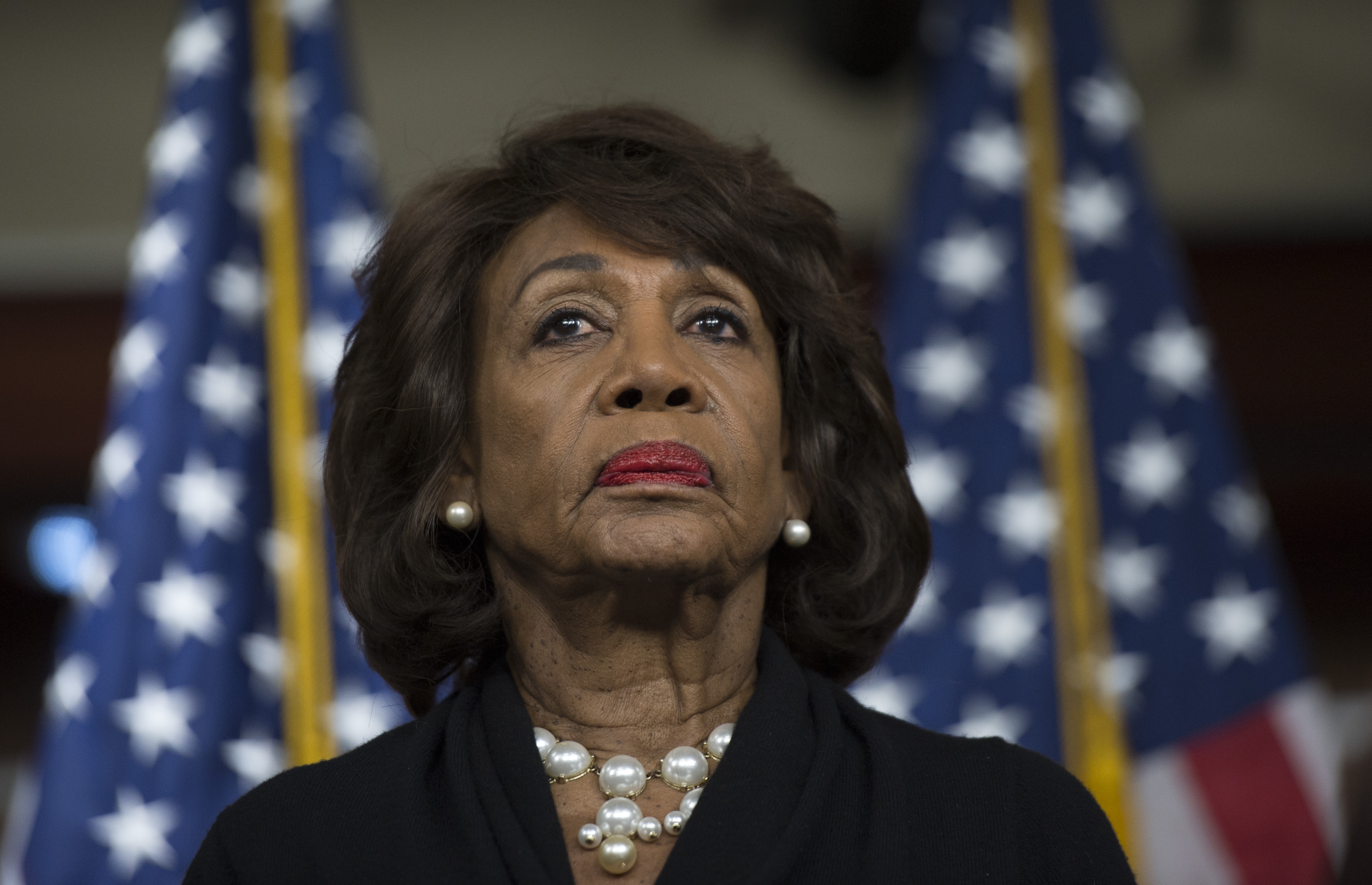 US Representative Maxine Waters (D-CA) looks on before speaking to reports regarding the Russia investigation on Capitol Hill in Washington, DC on January 9, 2018 (ANDREW CABALLERO-REYNOLDS/AFP/Getty Images)