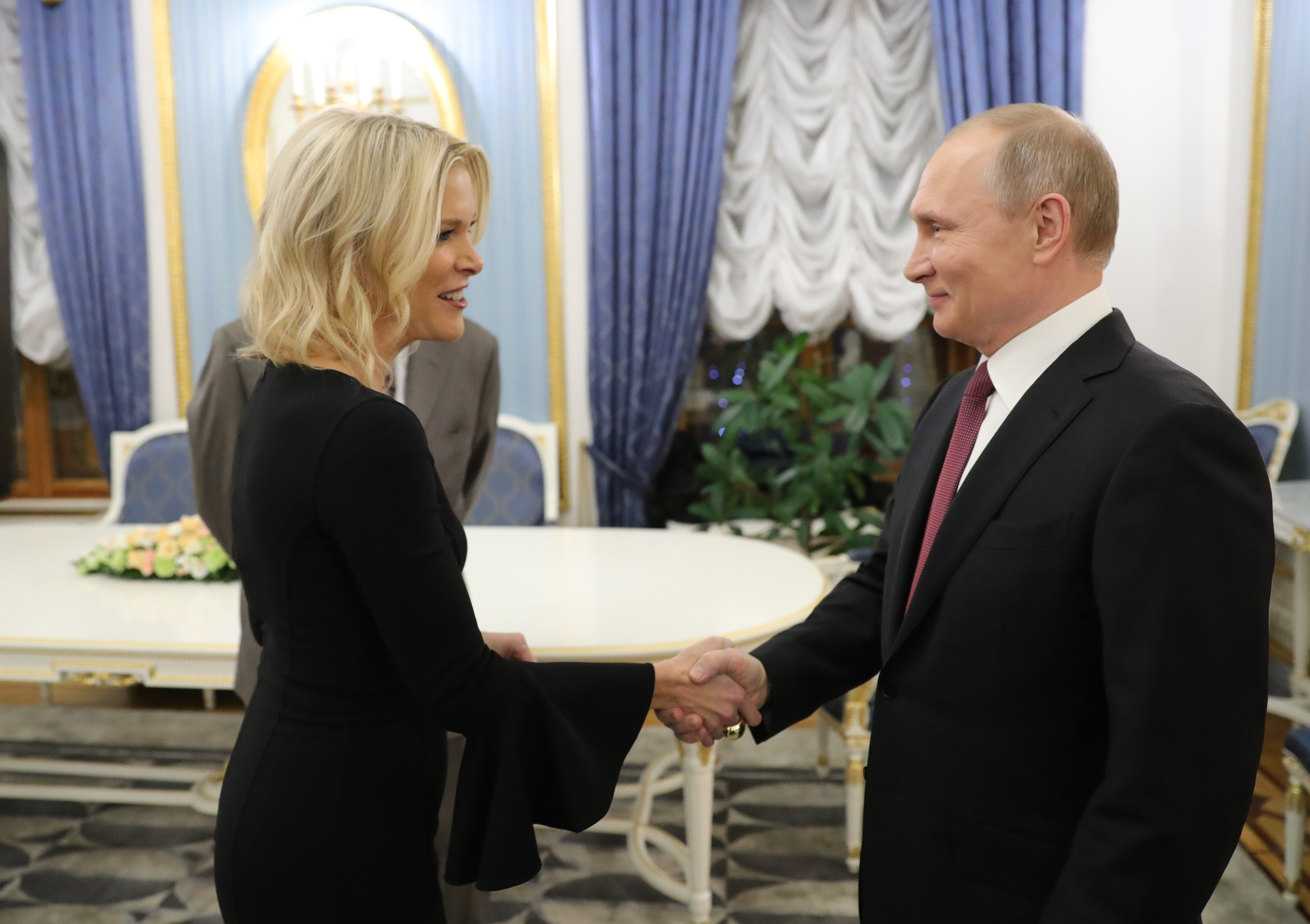 Russia's President Vladimir Putin (R) shakes hands with US NBC news network anchor Megyn Kelly prior to an interview at the Kremlin on March 1, 2018 in Moscow. (MICHAEL KLIMENTYEV/AFP/Getty Images)
