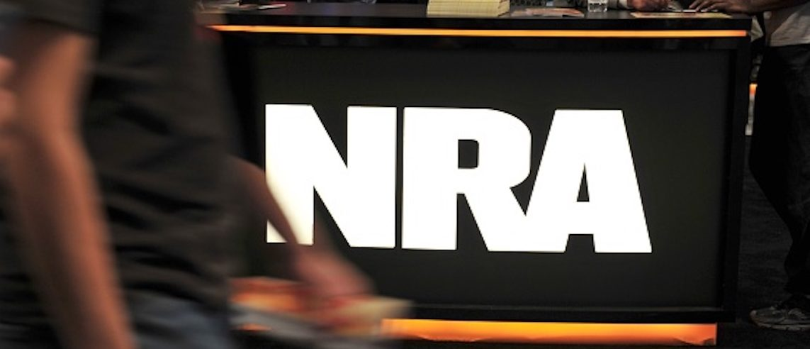 A convention goer passes the NRA desk at the 2015 NRA Annual Convention in Nashville, Tennessee on April 10, 2015. The annual NRA meeting and exhibit, expected to draw over 70,000 people, runs till April 12. AFP PHOTO / KAREN BLEIER / AFP PHOTO / KAREN BLEIER (Photo credit should read KAREN BLEIER/AFP/Getty Images)