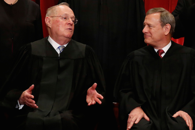 U.S. Supreme Court Justice Anthony Kennedy chats with Chief Justice John Roberts during a new U.S. Supreme Court family photo including Justice Neil Gorsuch, their most recent addition, at the Supreme Court building in Washington, D.C., June 1, 2017. REUTERS/Jonathan Ernst
